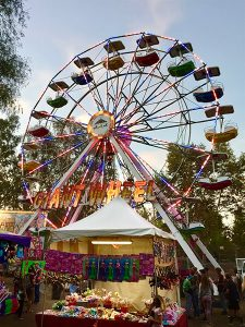 Carnival booth and Ferris Wheel amusement ride at the Clayton Oktoberfest
