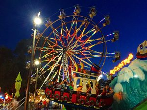 Ferris Wheel and Tug Boat carnival rides at the Clayton Oktoberfest