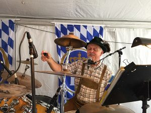 The Internationals drummer saluting the crowd in the beer garden tent at the Clayton Oktoberfest