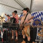 The Internationals band raising a toast in the authentic German beer garden at the Clayton Oktoberfest