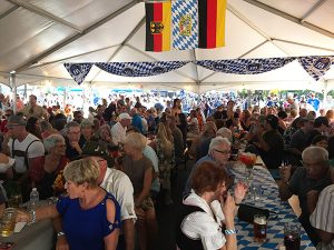 Festivities in the authentic German beer garden tent at the Clayton Oktoberfest