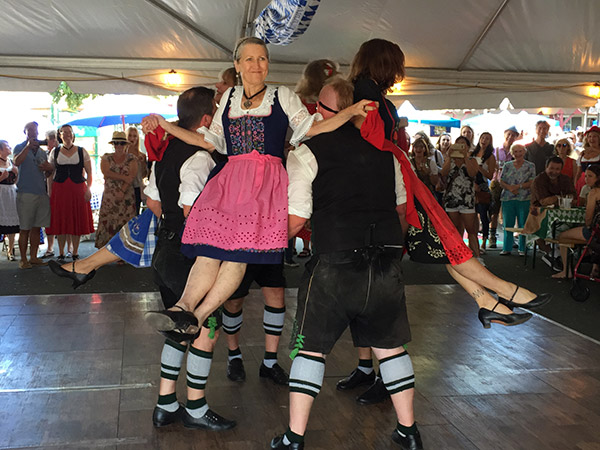 Dancing in the authentic German biergarten at the Clayton Oktoberfest